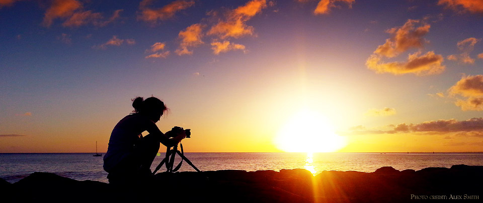 Anna photographing the sunset at Waikiki Beach, Oahu